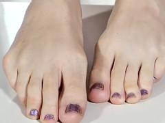 solo tgirl showing pedicured feet