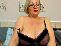 granny shows off her huge tits