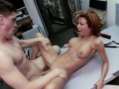 A hot milf with large boobs is fucking in the back room with a man