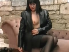 Sexy babe rubs her lovely boobs with leather jacket and topless femdom has whip ready