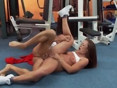 A pretty brunette is getting cumshot in her pretty face in the gym