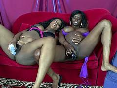 Pregnant ebony lesbians masturbate together on the sofa