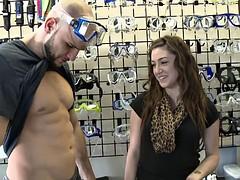 Girls show off tits in swim gear store