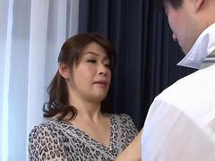 Busty Japanese cougar fondles her hairy jelly roll on couch
