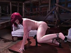 busty redhead shoves a thick dildo up her ass