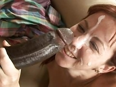 Good-looking redhead takes hefty facial cumshot from large BBC.