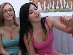 Youthful chicks with glasses giving a blowjob