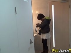 Asian teen taking a piss in toilet and get spied on