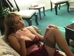 Mature slut blows a boy while smoking a cigarette