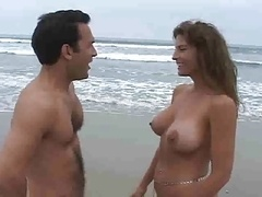 Milf with large bra buddies having an intercourse in the beach