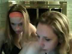 Two lesbian girls kissing between them
