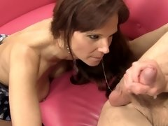 A big ass cougar is getting a dick in her pretty mouth to suck