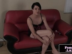 Masturbating femboy rides vibrator on couch