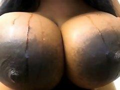 Giant black tits on webcam