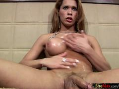 Brazilian shemale in miniskirt oils up her perfect bigtits