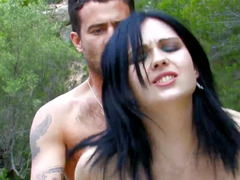 Black haired chick is banging her partner out in the open