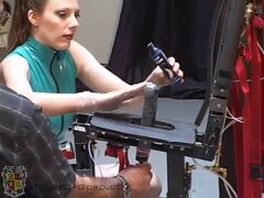 Gagged and bound brunette gets off from fuck machine